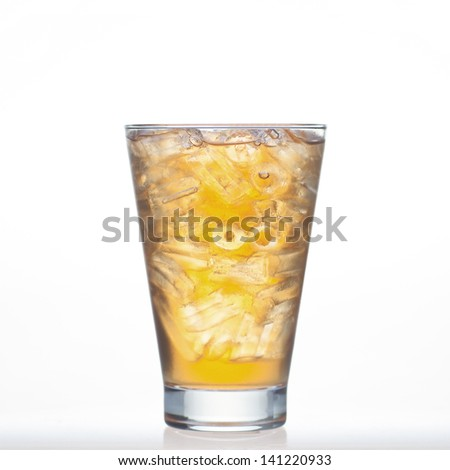 Bael tea Thai drinks style with ice in glass isolated on white background