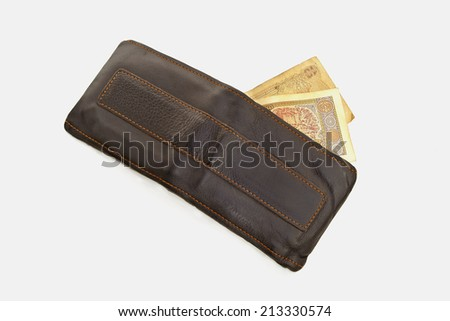 Bag and banknotes isolated on white background.