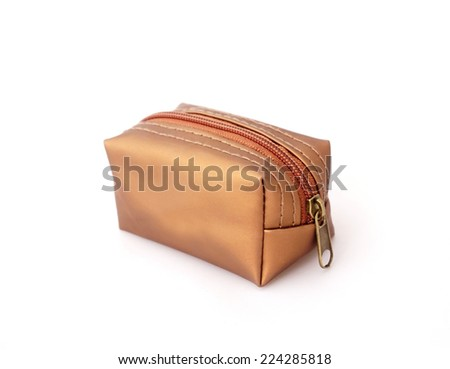 bag for cosmetics gold color, white background