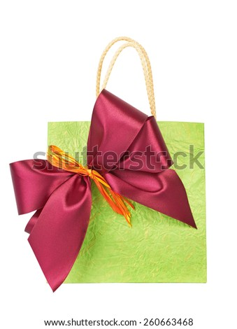 Bag for gift with bow, isolated on white background - stock photo