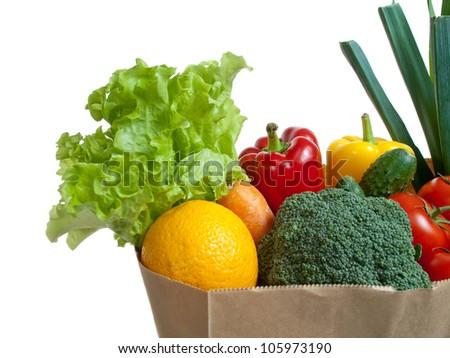 Bag full of vegetables, isolated on white - stock photo