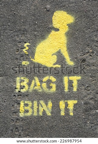 Bag it and Bin it sign printed on a path, to encourage cleaning up after your dog..