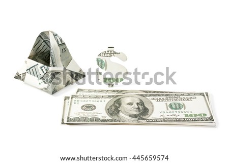 Bag made of hundred dollar bills next to the money as a concept of consumer isolated on white background - stock photo