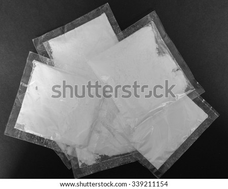 Bag of cocaine - simulated with sugar, no actual drugs used - stock photo