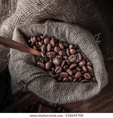Bag of coffee beans on a dark background. Macro. Shallow depth of field. View from above. - stock photo