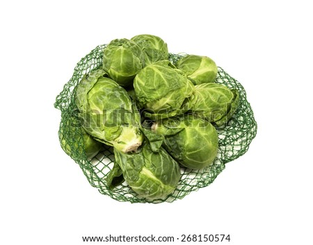 Bag of fresh Brussel Sprouts on a white background - stock photo