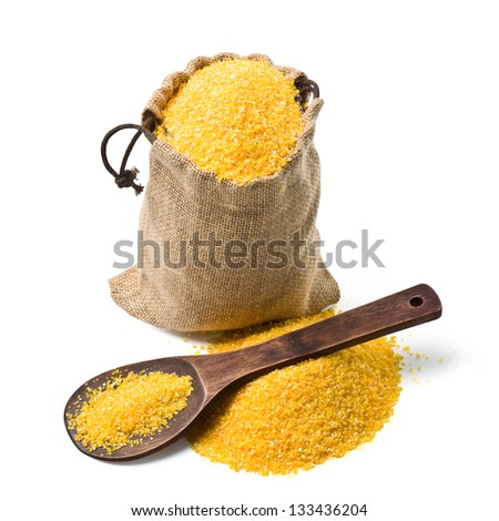 bag of ground corn and a wooden spoon on a white background. keeping paths - stock photo