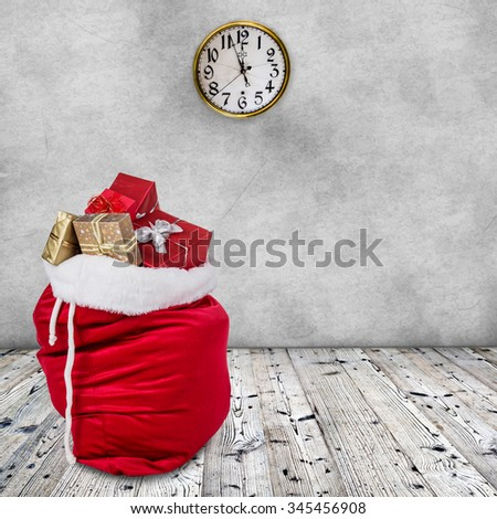 Bag of Santa Claus  on wooden background. - stock photo