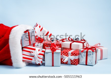 Bag of Santa Claus with gifts on blue background