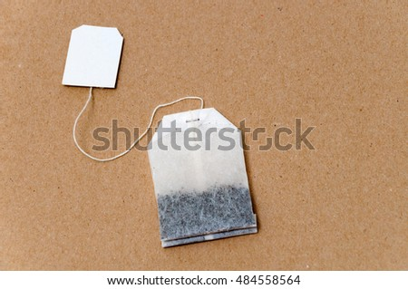 Bag of tea on textured background and copy space