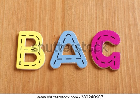 BAG, spell by woody puzzle letters with woody background