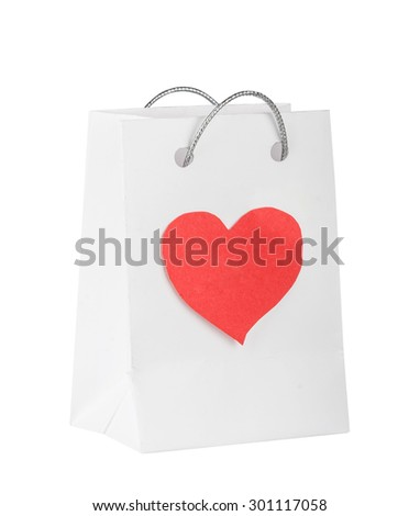 Bag with red heart for purchases on the white - stock photo