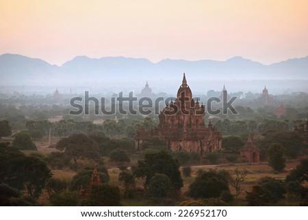 Bagan at sunset in Myanmar - stock photo