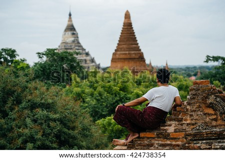 BAGAN-MARCH 24 :man posing near a temple on March 24, 2015 in Bagan, Myanmar