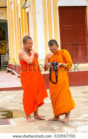 BAGAN, MYANMAR - AUG 29, 2016: Unidentified Burmese Buddhist monks with photo camera. 68 per cent of  Myanma people belong to Bamar ethnic group