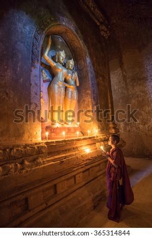 BAGAN, MYANMAR - DEC 13, 2015: Southeast Asian neophyte is in a Buddihist temple on December 13, 2015 in Bagan, Myanmar. - stock photo