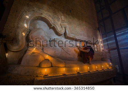 BAGAN, MYANMAR - DEC 13, 2015: Southeast Asian neophyte is in a Buddihist temple on December 13, 2015 in Bagan, Myanmar.