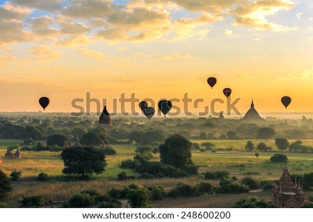 BAGAN, MYANMAR - DEC 6: Tourists enjoy taking the photo at Shwesandaw Pagoda on Dec 6, 2014 in Bagan. It is estimated that over 2200 temples and pagodas in Bagan still survive to the present day. - stock photo