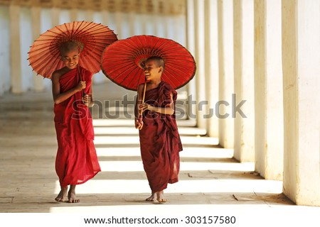 BAGAN, MYANMAR - DEC 6, 2014: Unidentified Buddhism neophyte playing little monk life style in Buddihist temple on December 6, 2014 in Bagan, Myanmar. Southeast Asian neophyte in a Buddihist temple - stock photo