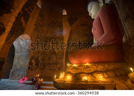 BAGAN, MYANMAR - DEC 12, 2015: Unidentified Buddhism neophyte prays in Buddihist temple on December 12, 2015 in Bagan, Myanmar. Southeast Asian neophyte praying in a Buddihist temple - stock photo