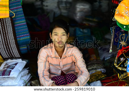 BAGAN, MYANMAR - FEB 25 : A woman sell handicraft in a temple on February 25, 2015 in Bagan, Myanmar. 89% of the Burmese population is Buddhist.  - stock photo