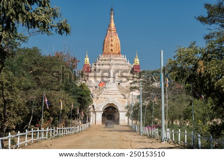 BAGAN, MYANMAR - FEBRUARY 7: Car approaches Ananda temple on February 7, 2014 in Bagan. Ananda temples was built in 1105 and is one of the most famous in Bagan. - stock photo