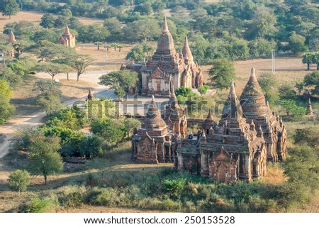 BAGAN, MYANMAR - FEBRUARY 7: Tourists explore a temple on February 7, 2014 in Bagan. Bagan is famous for its thousands of temples, pagodas and stupas. - stock photo