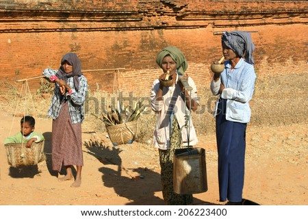 BAGAN, MYANMAR-JAN. 1, 2010:  Cheroot smoking is widespread in Myanmar as depicted by these women on January 1, 2010.   They are smoked as a mouth freshener because of the fragrance and sweet taste. - stock photo