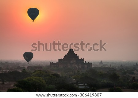 BAGAN, MYANMAR- MARCH 10, 2015: The tourists' balloons and the sunrise over Bagan.