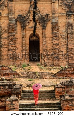 BAGAN, MYANMAR March 12: Unidentified women at Shwezigon temple on March 12, 2016 in Bagan. Buddhism is predominantly of the Theravada tradition - stock photo