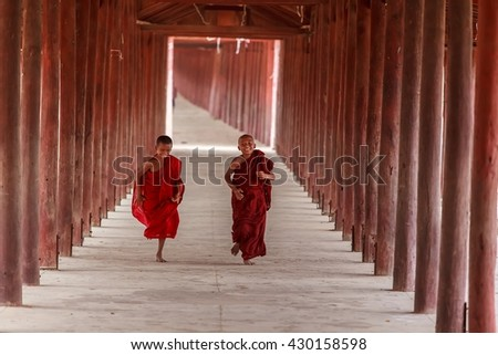 BAGAN, MYANMAR - march 10 : Unidentified young Buddhism novices are playing and relaxing at Shwezigon temple on March 10, 2016 in Bagan,Myanmar - stock photo