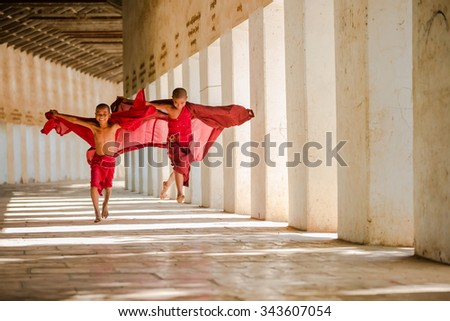 BAGAN, MYANMAR - NOVEMBER 22 : Unidentified young Buddhism novices are playing and relaxing at Shwezigon temple on November 22, 2015 in Bagan,Myanmar - stock photo
