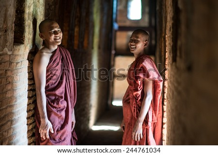 BAGAN - MYANMAR - OCT 24,2014: An unidentified Burmese Buddhist novice on October 24, 2014 in Mandalay, Myanmar. In 2014.Myanmar is the most religious Buddhist country. - stock photo