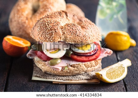 Bagel sandwich with turkey breast,selective focus  - stock photo