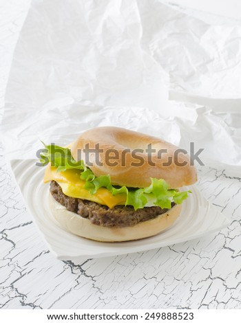 Bagel with Angus beef, egg, cheese and lettuce.