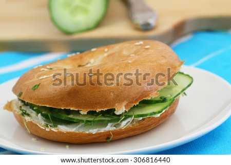 Bagel with cream cheese and cucumber  - stock photo