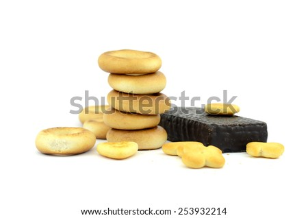 bagels and chocolate wafer candy on a white background - stock photo