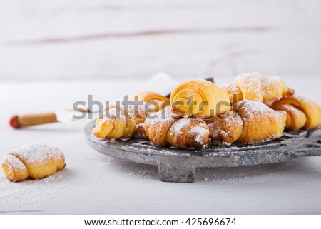 Bagels sprinkled with powdered sugar on a white background.croissant,cakes are homemade.