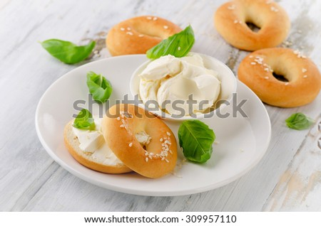 Bagels with cream cheese for healthy breakfast. Selective focus - stock photo