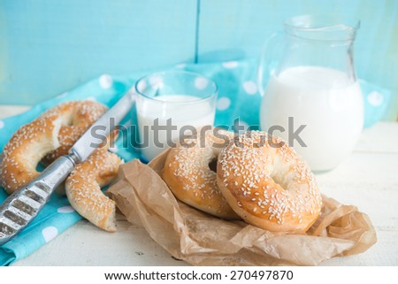 bagels with sesame and milk - stock photo