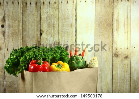 Bagged Grocery Produce Items on a Wooden Plank - stock photo