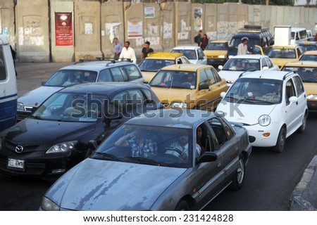 BAGHDAD, IRAQ - AUGUST 22: Daily traffic jam in Bagdad on August 22, 2011 in Bagdad, Iraq. Security measure has been taken by sealing off the road with concrete barriers.