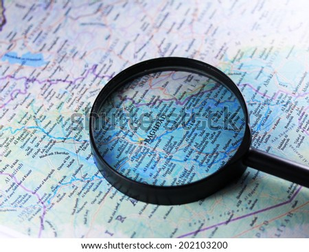 Baghdad on a map close up with magnifier - stock photo