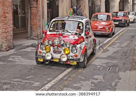 "BAGNACAVALLO, RA, ITALY - NOVEMBER 9: driver on a custom vintage car Fiat 500 F (1965) in classic car rally during the feast ""Sagra dei sapori d'autunno"" on November 9, 2014 in Bagnacavallo, RA, Italy"