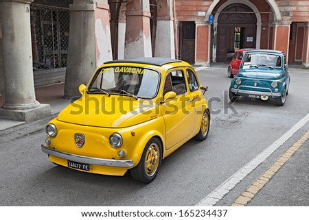"BAGNACAVALLO, RA, ITALY - NOVEMBER 10: unidentified driver on a yellow vintage car Fiat 500 Abarth in the rally ""Meeting Fiat 500"" on November 10, 2013 in Bagnacavallo, RA, Italy"