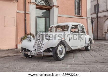 "BAGNACAVALLO, RA, ITALY - NOVEMBER 9: vintage car Citroen Traction Avant 11BL (1939) in classic cars rally during the feast ""Sagra dei sapori d'autunno"" on November 9, 2014 in Bagnacavallo, RA, Italy  - stock photo"