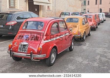 "BAGNACAVALLO, RA, ITALY - NOVEMBER 9: vintage car Fiat Nuova 500 D Moretti (1963) in classic cars rally during the feast ""Sagra dei sapori d'autunno"" on November 9, 2014 in Bagnacavallo, RA, Italy  - stock photo"