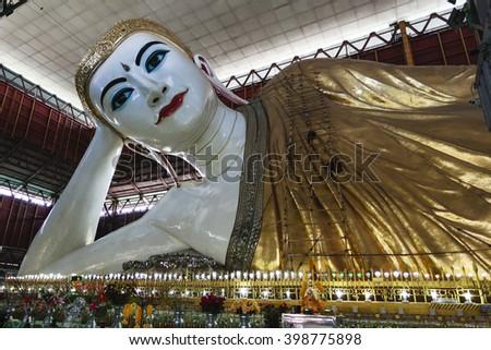 Bago, MYANMAR - Feb 3 : Shwethalyaung Reclining Buddha on Feburary 3, 2016 in Bago, Myanmar. It is the most famous reclining buddha in Bago, Myanmar. - stock photo