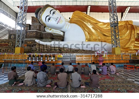 BAGO, Myanmar - OCT 5: Unidentified many burmese praying at Shwethalyaung Reclining Buddha on October 5, 2012 in Bago, Myanmar. The place is very respectable people of Burma - stock photo