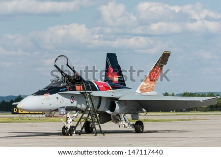 BAGOTVILLE, QUEBEC/CANADA  - JUNE 22: Bagotville Airshow. The Royal Canadian Air Force (RCAF) CF-18 landed and ready to fly in Bagotville, Quebec, Canada on June 22, 2013. - stock photo
